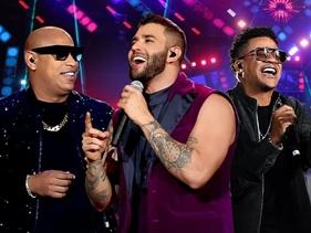 """Gusttavo Lima se junta ao duo cubano Gente de Zona no clipe ao vivo de """"Lo Que Tú y Yo Vivimos"""""""